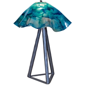 Pictured is our wrought iron Tripod Table Lamp with Glass Shade hand-forged by Mathews and Company.