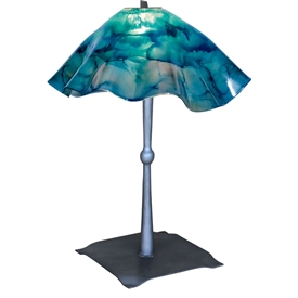 Pictured is our wrought iron Cottonwood Table Lamp with Glass Shade hand-forged by Mathews and Company.