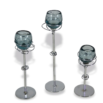 Pictured here is the Gyro Iron Candle Holders with Glass Set of 3  from Mathews and Company