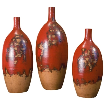 Pictured here are the Melon Ceramic Vases Set of 3 in our aged red finish.