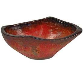 Pictured here is the handcrafted Taos Large Ceramic Bowl in our Rocky Red finish which measures 19 inches long by 13 inches wide by 8 inches high.