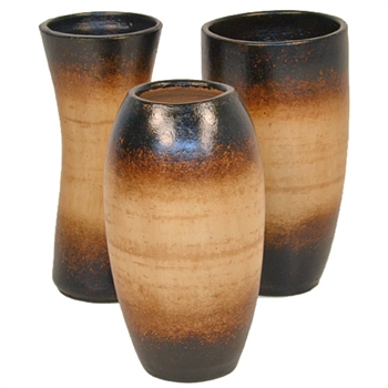 Pictured here is the set of 3 Tiny Ceramic Vases in our aged black finish.