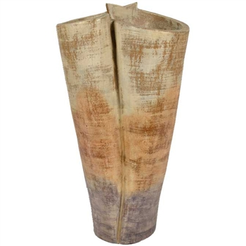 Pictured here is the handcrafted Twisted Ceramic Floor Vase in our Slate finish which measures 16 inches in diameter by 31 inches high.