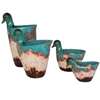 Pictured here is the handcrafted ceramic Riverton Ducks in our teal top finish, sold as a set of 4 - small, medium, large and extra large.