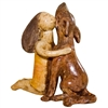Pictured here is the handcrafted Ceramic Girl with Dog Sculpture which measures 9 inches long by 5 inches wide by 9 inches high.