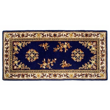 Pictured is the 56 inch x 26 inch Rectangular Blue Fireplace Rug manufactured in America by Minuteman.