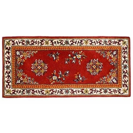 Pictured is the 56 inch x 26 inch Wool Fire Resistant Burgundy Hearth Rug manufactured in America by Minuteman.