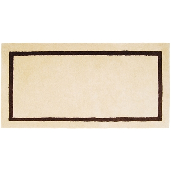 Pictured is the Minuteman Mesa Tan Rectangular Fireplace Rug that measures 44-inch x 22-inch and meets CPSC Standard FF1-70 for flammability of carpets.