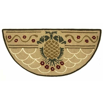 Pictured is the 56 inch x 26 inch Hospitality Half Round Hearth Rug with Pineapple manufactured in America by Minuteman.