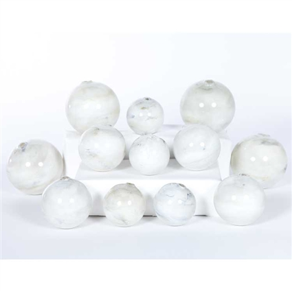 Pictured is an assortment of 12 Glass Spheres in random sizes and Smoke finish.