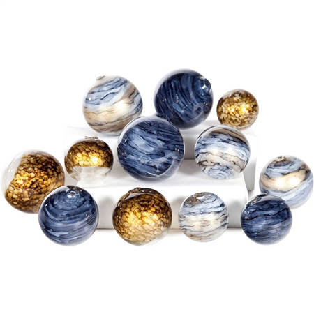Pictured is an assortment of 12 Glass Spheres in random sizes and colors including glimmer, mythic & cheers.
