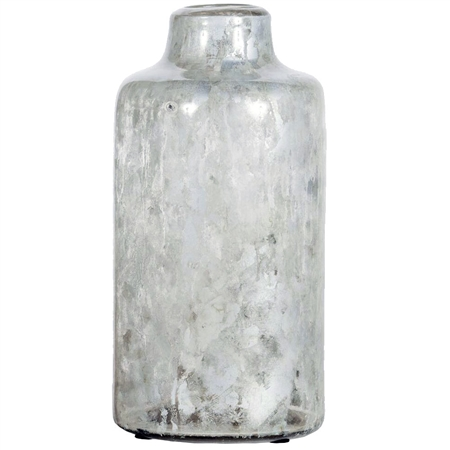 Pictured here is the Oyster Shell Medium Glass Vase, hand-made from recycled glass.