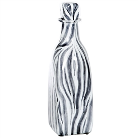 Pictured here is the Zebra Medium Glass Bottle, hand-made from recycled glass.