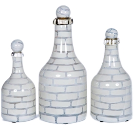 Pictured here is a set of 3 Mirage Glass Bottles in small, medium and large sizes.