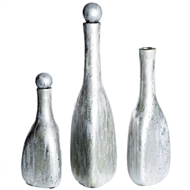Pictured here is a set of 3 Shimmering Dawn Glass Bottles in small, medium and large sizes.