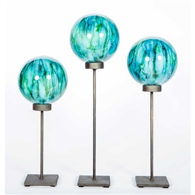 Pictured here is the Set of 3 Glass Balls on Stands in Lake Como, hand-made from recycled glass.