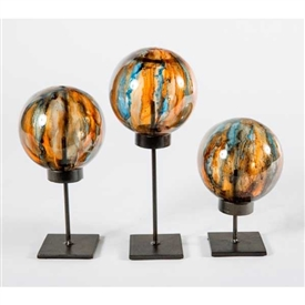 Pictured here is the Set of 3 Glass Balls on Stands in Flagstone, hand-made from recycled glass.