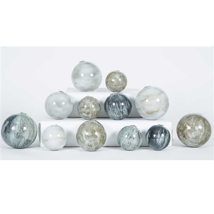 Pictured is an assortment of 12 Glass Spheres in random sizes and colors including Black Sand, Oyster Shell and Smoke.
