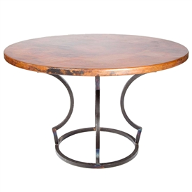 "Pictured here is the Charles Dining Table with Wrought iron base and 54"" Round Hammered Copper Table Top"