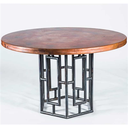 "Pictured here is the Hudson Dining Table with Wrought iron base and 48"" Round Hammered Copper Table Top"