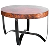 Pictured here is the Round Strap Coffee Table with Wrought iron base and Hammered Copper Table Top