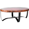 Pictured here is the Oval Strap Cocktail Table with Wrought iron base and Hammered Copper Table Top