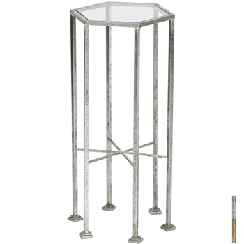 Pictured is the Esher Accent Table which features a Glass table top and a Metal frame with your choice of Silver Leaf or Gold Leaf finish options by Prima that measures 12-in x 12-in x 25-in
