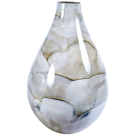 Pictured here is the smoke colored bottle made by hand from recycled glass.