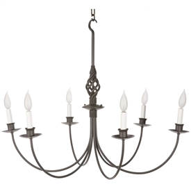 Pictured here is the hand-forged Basketweave 6-Arm Chandelier with natural black finish and amber candle lights