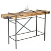 Pictured here is the Studio Console Table with raw wood slab table top married to a hand-forge iron table base.