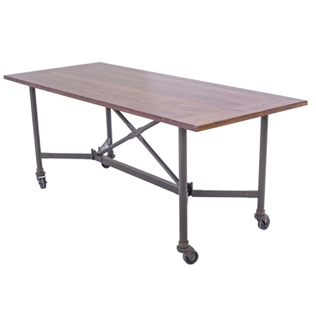 Pictured here is the Trestle Iron dining table with wood table top.
