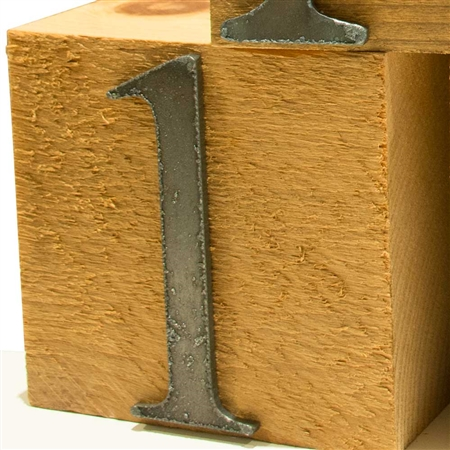 Pictured here are Vintage Number Blocks with rustic iron numbers on reclaimed 4x4 wood blocks available in 0-9.