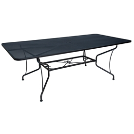 "Pictured is the Mesh Top 42"" x 84"" Rectangle Table -8 Spoke from Woodard Outdoor Furniture, sold by Timeless Wrought Iron."