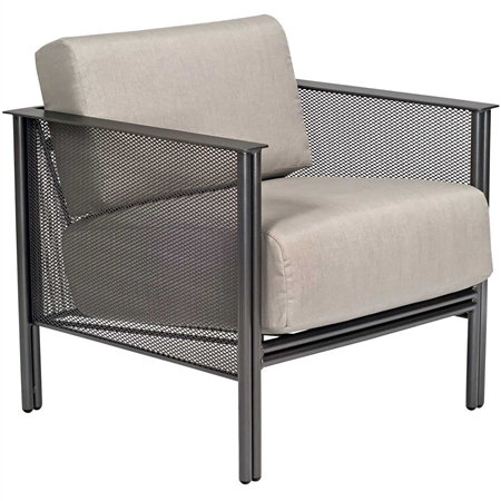 Pictured is the Jax Stationary Lounge Chair from Woodard Outdoor Furniture, sold by Timeless Wrought Iron.