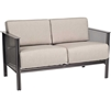 Pictured is the Jax Loveseat from Woodard Outdoor Furniture, sold by Timeless Wrought Iron.