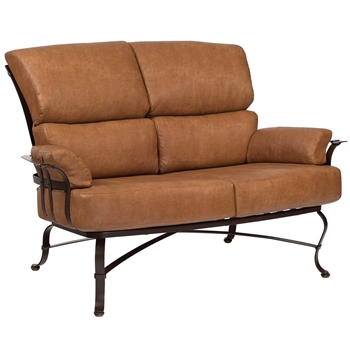 Pictured here is the Atlas Outdoor Love Seat with upholstered seat cushions from Woodard.