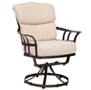 Pictured here is the Atlas Outdoor Swivel Dining Chair with upholstered all-weather seat cushions from Woodard.
