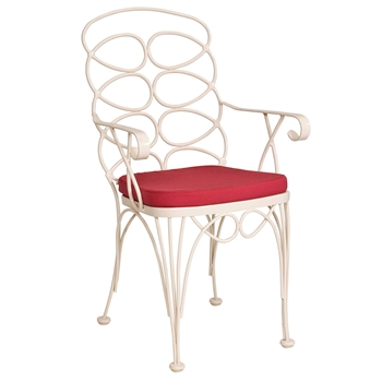 Pictured is the Gelati Bistro Arm Chair from Woodard Outdoor Furniture, sold by Timeless Wrought Iron.