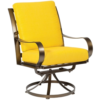 Pictured here is the Cascade Outdoor Swivel Dining Chair with upholstered all-weather seat cushions from Woodard.