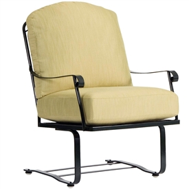 Pictured is the Fullerton Spring Lounge Chair from Woodard Outdoor Furniture, sold by Timeless Wrought Iron.