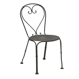 Pictured is the Parisienne Pattern Metal Seat Side Chair from Woodard Outdoor Furniture, sold by Timeless Wrought Iron.