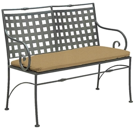 Pictured is the Sheffield Bench from Woodard Outdoor Furniture, sold by Timeless Wrought Iron.