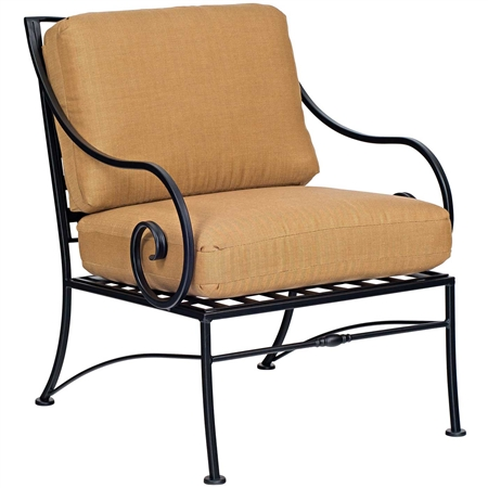 Pictured is the Sheffield Lounge Chair from Woodard Outdoor Furniture, sold by Timeless Wrought Iron.