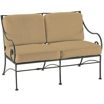 Pictured is the Sheffield Loveseat from Woodard Outdoor Furniture, sold by Timeless Wrought Iron.
