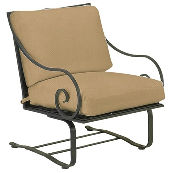 Pictured is the Sheffield Spring Lounge Chair from Woodard Outdoor Furniture, sold by Timeless Wrought Iron.