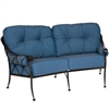 Pictured is the Derby Crescent Loveseat from Woodard Outdoor Furniture, sold by Timeless Wrought Iron.