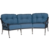 Pictured is the Derby Crescent Sofa from Woodard Outdoor Furniture, sold by Timeless Wrought Iron.