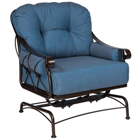 Pictured is the Derby Spring Lounge Chair from Woodard Outdoor Furniture, sold by Timeless Wrought Iron.