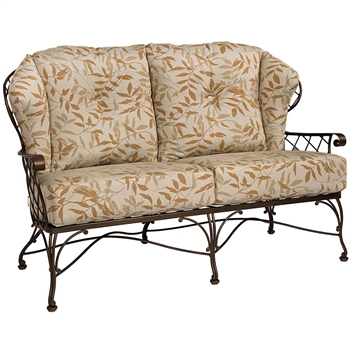Pictured is the Brayden Love Seat from Woodard Outdoor Furniture, sold by Timeless Wrought Iron.