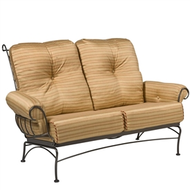 Pictured is the Terrace Loveseat from Woodard Outdoor Furniture, sold by Timeless Wrought Iron.